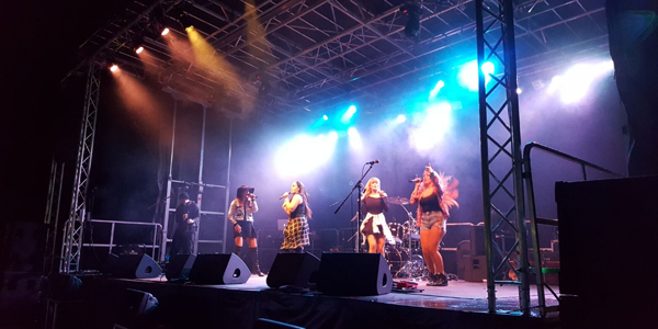 Events Management with singers on a stage at a concert